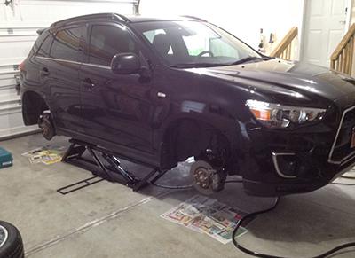 QuickJack Garage Lift with SUV